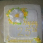 white cake with royal icing & fondant flower